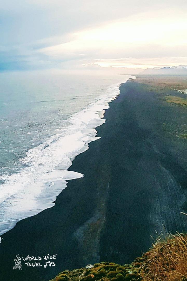 Sunset from Dyrholaey Cape toward black sand beach