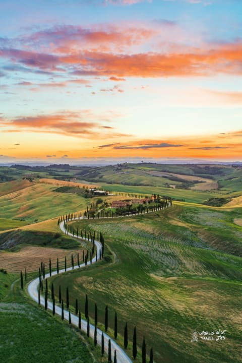 Italy San Quirico dOrcia Sunset in Tuscany hills