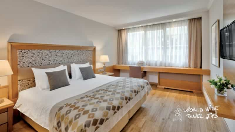 Divani Caravel Hotel King Size Bed Room