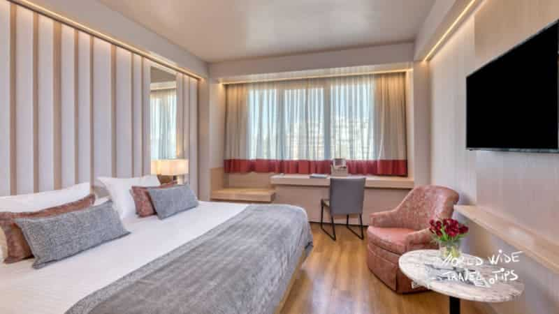 Divani Caravel Hotel Luxury Room King Size Bed