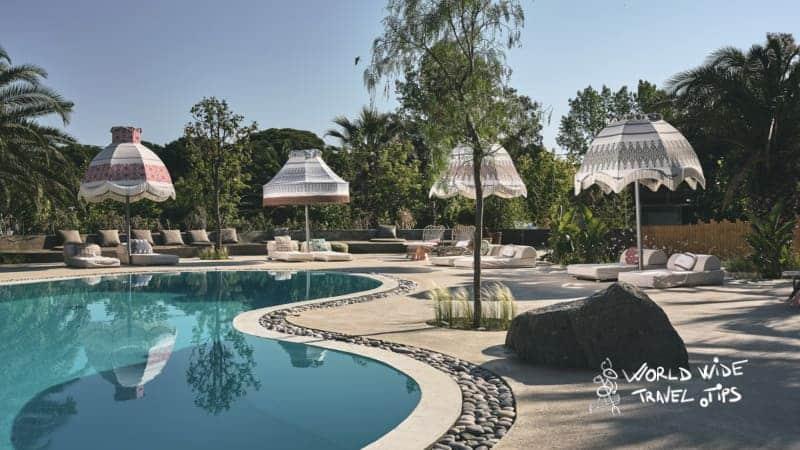 Ekies All Senses Resort Pool sunbeds