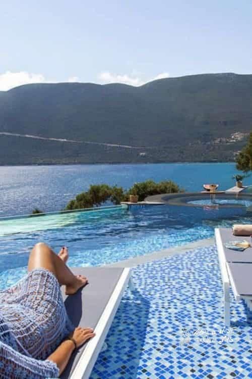 Sappho Boutique Suites Infinity Pool sun beds
