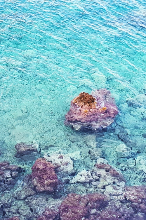 Turquoise water clear rocky shore Greek Island near Athens